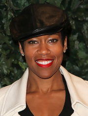Regina King dressed up her look with a black leather ivy cap and bright red lips at the QVC Red Carpet Style party.