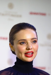 Miranda Kerr's candy apple red lips looked crisp and lovely on the stunning model.