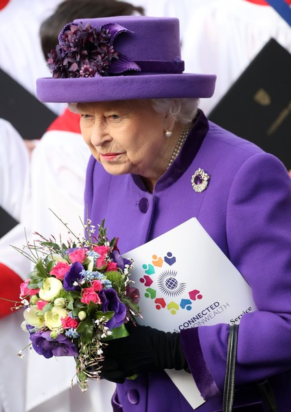 Queen Elizabeth II Gemstone Brooch [purple,tradition,flower,plant,ceremony,floristry,hat,performance,elizabeth ii,people,cooperation,commonwealth,countries,england,london,westminster abbey,commonwealth service,commonwealth day]