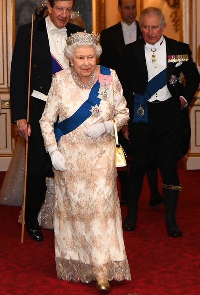 Queen Elizabeth II Lace Dress [flooring,carpet,senior citizen,formal wear,tradition,red carpet,ceremony,fun,costume,event,members,charles,elizabeth ii,military personnel,guests,wales,diplomatic corps,the duke duchess of cambridge,reception,reception]