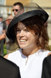 Princess Eugenie topped off her look with a black mesh hat when she attended a Buckingham Palace garden party.