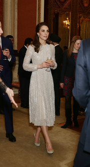 Kate Middleton looked breathtaking in a metallic lace midi dress by Erdem at the launch of the UK-India Year of Culture 2017.