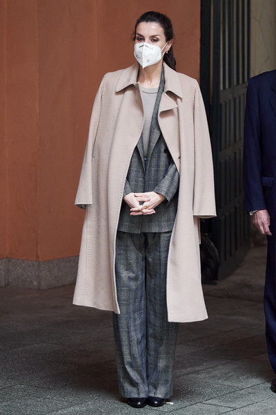 Queen Letizia of Spain arrived for a meeting at the Royal Academy of Engineering wearing a beige wool coat over a plaid pantsuit.