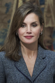 Queen Letizia of Spain accessorized with a pair of diamond and aquamarine hoops by Bulgari.