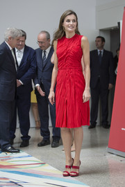 Queen Letizia of Spain matched her dress with strappy red sandals by Magrit.