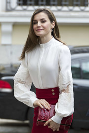 Queen Letizia of Spain accessorized with a chic red snakeskin clutch by Carolina Herrera at the Microfinanzas BBVA 10th anniversary.