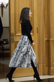 Queen Letizia of Spain teamed black over-the-knee boots by Magrit with a matching sweater and a printed skirt to attend audiences at Zarzuela Palace.