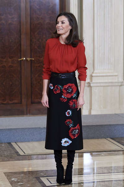Queen Letizia paired her top with a poppy-print pencil skirt by Carolina Herrera.