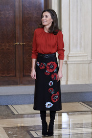 Queen Letizia of Spain donned a long-sleeve red blouse by Hugo Boss for an audience at Zarzuela Palace.