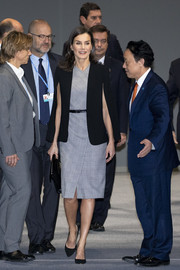 Queen Letizia of Spain layered a black cape blazer by Zara over a gray glen plaid dress for the COP25 Climate Conference.