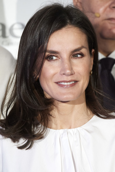 Queen Letizia of Spain wore her hair in a flippy layered cut while attending a forum against cancer.