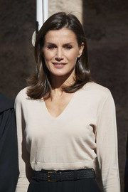 Queen Letizia of Spain wore a stylish black leather belt with her trousers and sweater while attending a journalism and language seminar.