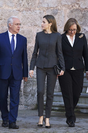 Queen Letizia of Spain kept it business-chic in a gray pantsuit by Hugo Boss while attending a journalism and language seminar.