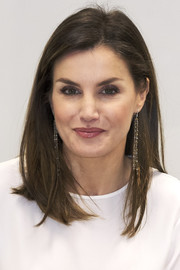 Queen Letizia of Spain kept her beauty look simple with a glossy lip and neutral eyeshadow.
