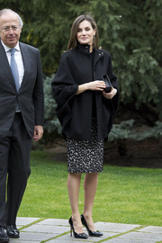 Queen Letizia of Spain headed to the International Friendship Award 2018 wearing a black Hugo Boss cape and a leopard-print pencil skirt.