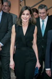 Queen Letizia of Spain paired a studded teal clutch with a black jumpsuit for the Barco de Vapor event.