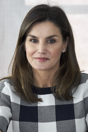 Queen Letizia of Spain sported her signature demure lob while visiting a traditional students' residence in Madrid.
