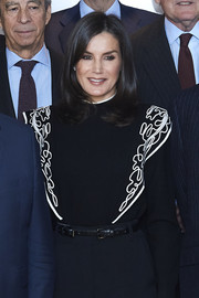 Queen Letizia of Spain accessorized with a stylish double-buckle belt for her visit to the Foundation Against Drug Addiction headquarters.