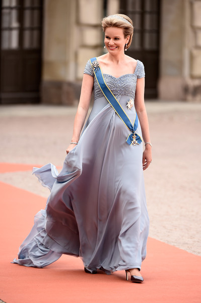 Queen Mathilde of Belgium Empire Gown [carl philip of sweden,arrivals,mathilde of belgium,sofia hellqvist,fashion model,clothing,dress,blue,fashion,gown,shoulder,lady,beauty,formal wear,wedding,ceremony,wedding,the royal palace,sweden,stockholm]