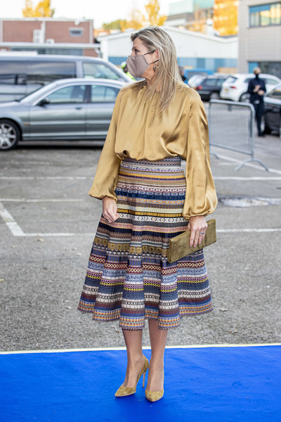 Queen Maxima's suede clutch was a perfect match to her footwear.