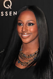 Alexandra Burke's eyes were seriously sexy at the Quintessentially Awards.  To try her sultry, eye-enhancing look, use a black eye pencil to heavily line upper and lower lash lines and inner rims, then lightly smudge and draw out color past the outer corners of the eyes.