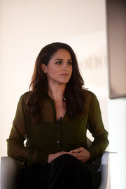 Meghan Markle attended the Reebok Women's 25,915 luncheon wearing a sheer green button-down and black pants.