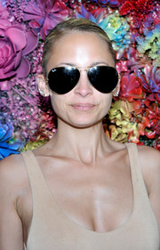 Nicole Richie styled her hair into a casual bun for the Revolve Desert House party during Coachella.