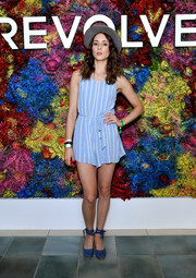 Troian Bellisario was easy-breezy in a striped blue romper at the Revolve Desert House party during Coachella.