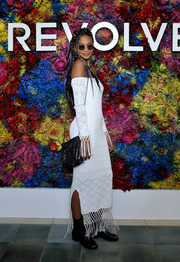 Chanel Iman got majorly boho in a fringed, off-the-shoulder maxi dress for the Revolve Desert House party during Coachella.