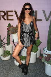 Sara Sampaio hit the Revolve Desert House event wearing a breezy geometric-print romper.
