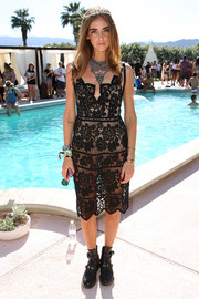 Chiara Ferragni showed plenty of skin in a sheer black lace dress by For Love & Lemons at the Revolve Desert House event.