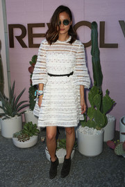 Jamie Chung toughened up her dress with black suede ankle boots by Grey City.