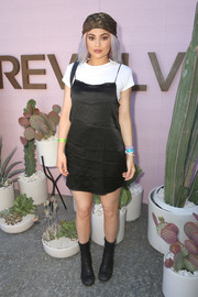 Kylie Jenner kept it simple in a black slip dress by The Row layered over a white T-shirt when she visited the Revolve Desert House.