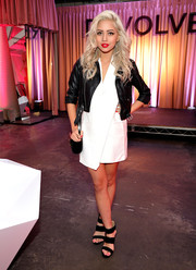 Amy Pham teamed a wrap-around LWD with a cropped black leather jacket for the Revolve Pop-Up launch.