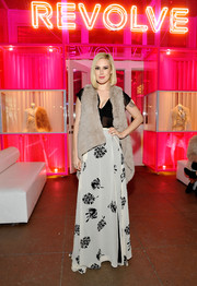 Rumer Willis arrived for the Revolve Pop-Up launch wearing a nude fur vest over a sheer black blouse.