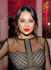 Janel Parrish looked romantic wearing this loose ponytail with wavy tendrils down both sides during the Revolve Pop-Up launch.