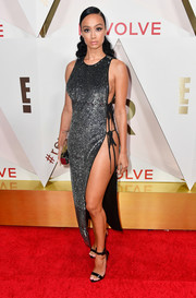 Draya Michele paired her slinky dress with black patent sandals.