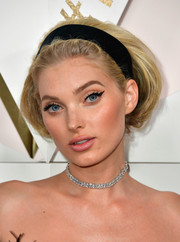 Elsa Hosk kept her cute coiffure in place with a wide black headband.