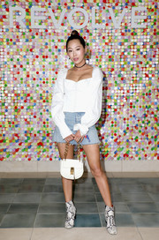 Aimee Song paired her cute top with a denim mini skirt by Grlfrnd.