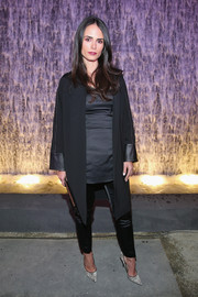 Jordana Brewster paired her black duster coat with a satin top and pants for a chic ensemble.