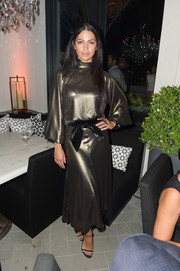 Camila Alves was glowing in a loose gold blouse by Johanna Ortiz at the RH West Palm private party.