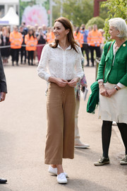Kate Middleton teamed her shirt with cropped wide-leg trousers by Massimo Dutti.