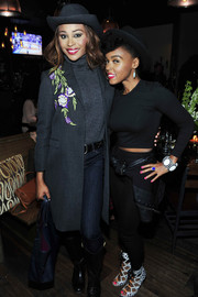 Cynthia Bailey layered a floral-embroidered gray coat over a turtleneck for the 'Rio 2' listening after-party.