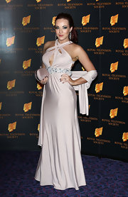 Stephanie Davis chose a retro-glam style dress with a beaded belt and strappy neckline for her red carpet look.