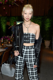Soo Joo Park attended the Always Sparkling dinner carrying a tasseled black shoulder bag.