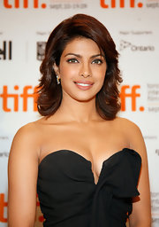 You will never see Priyanka without stunning hair.  This style is both elegant and spunky with the side swept bangs, variety of layers and modern shoulder length.