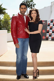 Abhishek showed off a little fashion flair in a red zip-up leather jacket. He completed his look with classic jeans.