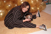 Rachael Ray teamed silver oxfords with a striped pajama suit for the 10th anniversary celebration of her pet food brand, Nutrish.