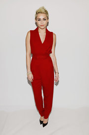 Miley rocked a rich red belted jumpsuit with a blousy '80s silhouette to the Rachel Zoe fashion show.