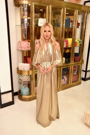 Rachel Zoe was a glamorous diva in a gold cold-shoulder gown from her own label at the Rachel Zoe x What Goes Around Comes Around pop-in.